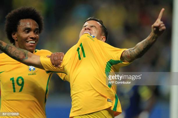 Brazil's Philippe Coutinho celebrates with teammate Willian after scoring against Ecuador during their 2018 World Cup football qualifier match in...