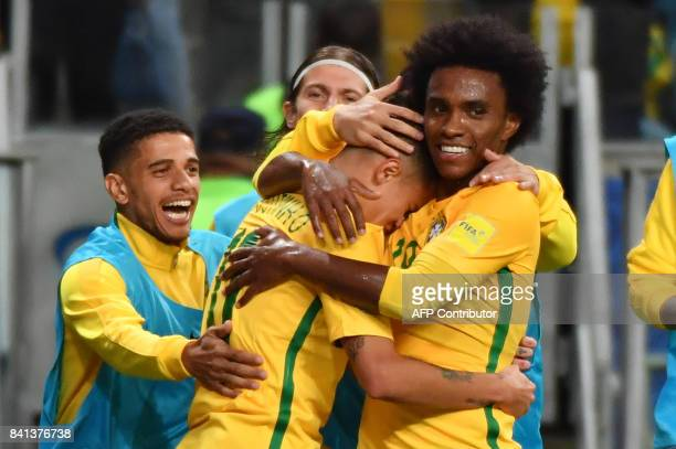 Brazil's Philippe Coutinho celebrates with teammates after scoring against Ecuador during their 2018 World Cup football qualifier match in Porto...