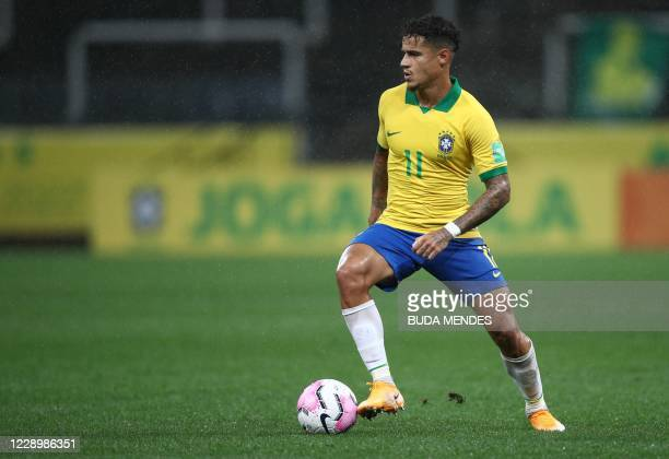 Brazil's Philippe Coutinho drives the ball during the 2022 FIFA World Cup South American qualifier football match against Bolivia at the Neo Quimica...