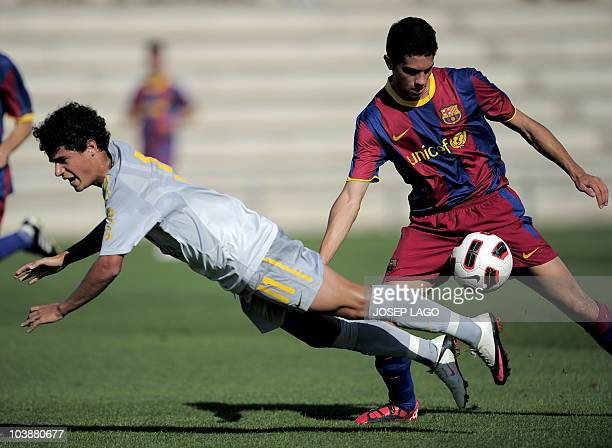 Brazil's Philippe Coutinho vies for the ball with Barcelona B Victor Vazquez during a friendly football match on September 7 at the FC Barcelona Joan...