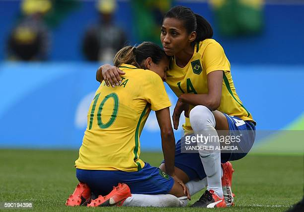 TOPSHOT Brazil's player Bruna comforts teammate Marta after losing to Sweden in their Rio 2016 Olympic Games Women's semifinal football match at the...