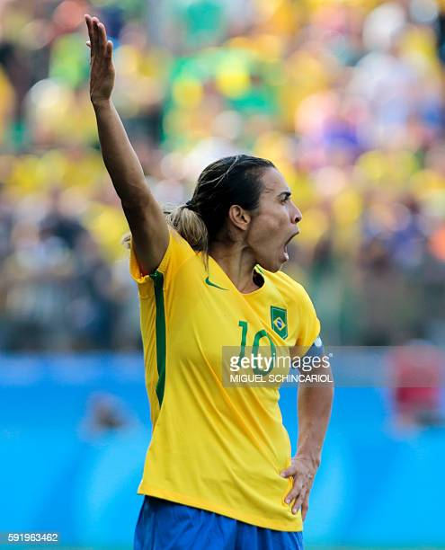 Brazil's player Marta reacts during their Rio 2016 Olympic Games women's bronze medal football match Brazil vs Canada at the Arena Corinthians...