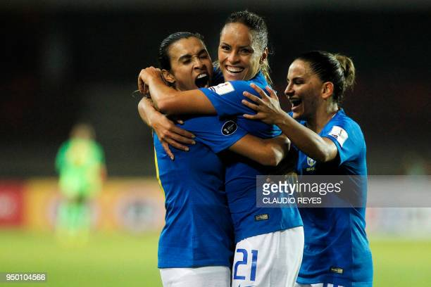 Brazil's player Monica Hickmann celebrates with teammates after scoring against Colombia during the women's Copa America match at La Portada stadium...
