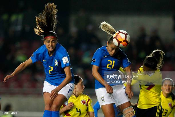 Brazil's player Monica Hickmann heads the ball to score against Colombia during the women's Copa America match at La Portada stadium in Serena Chile...