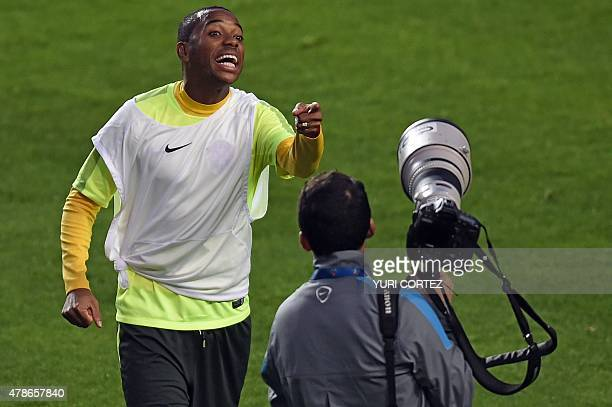 Brazil's player Robinho gestures after a training session at the Ester Roa stadium in Concepcion, Chile, on June 26 on the eve of their Copa America...