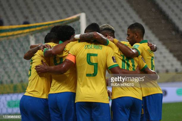 Brazil's players celebrate a goal during the 2022 FIFA World Cup South American qualifier football match against Bolivia at the Neo Quimica Arena,...