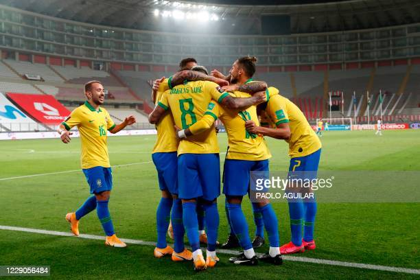 Brazil's players celebrate after teammate Neymar scored against Peru during their 2022 FIFA World Cup South American qualifier football match at the...