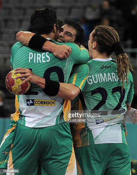 Brazil's players celebrate after winning the 23rd Men's Handball World Championships preliminary round Group A match Montenegro vs Brazil at the...