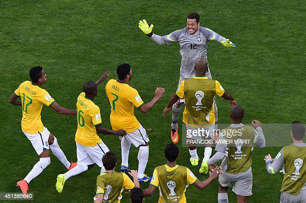 Brazil's players celebrate at the end of the round of 16 football match between Brazil and Chile at The Mineirao Stadium in Belo Horizonte during the...