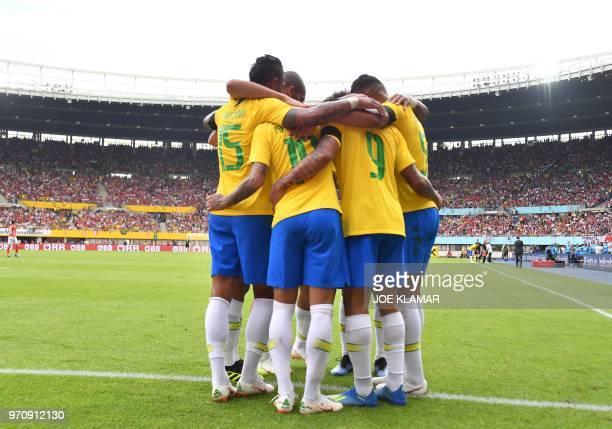 Brazil's players celebrate scoring during the international friendly footbal match Austria vs Brazil in Vienna on June 10 2018
