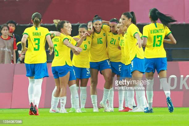 Brazil's players celebrate their fourth goal during the Tokyo 2020 Olympic Games women's group F first round football match between China and Brazil...