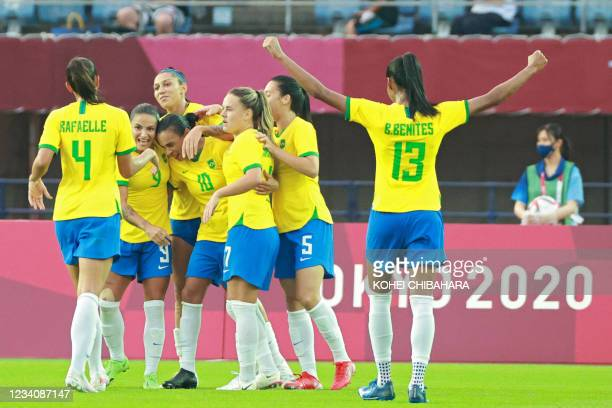 Brazil's players celebrate their third goal during the Tokyo 2020 Olympic Games women's group F first round football match between China and Brazil...