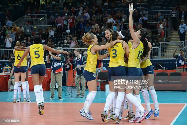 Brazil's players celebrate their victory in the Women's quarterfinal volleyball match between Russia and Brazil in the 2012 London Olympic Games in...