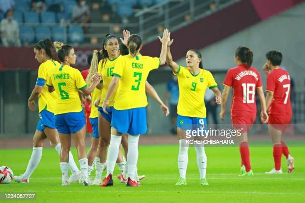 Brazil's players celebrate their win in the Tokyo 2020 Olympic Games women's group F first round football match between China and Brazil at the...