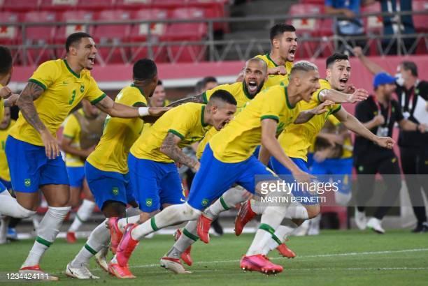 Brazil's players celebrate winning the Tokyo 2020 Olympic Games men's semi-final football match between Mexico and Brazil at Ibaraki Kashima Stadium...