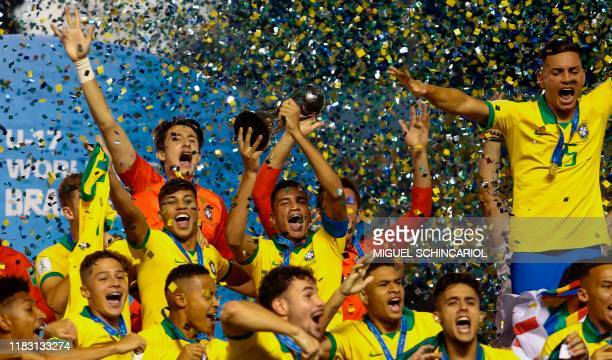 Brazils players celebrate with their medals after winning the FIFA U-17 Men's World Cup Brazil 2019 final football match against Mexico at the...