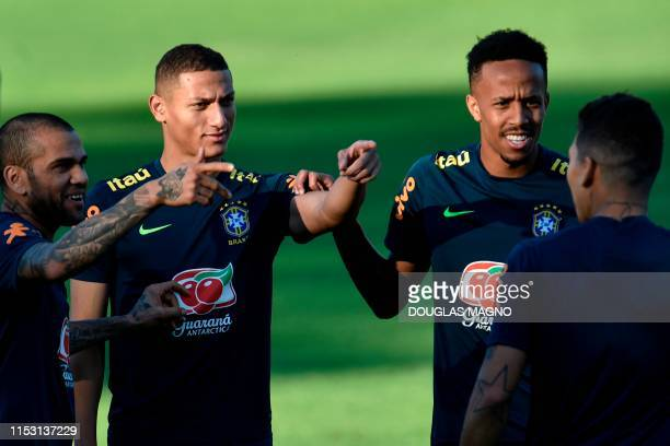 Brazil's players Dani Alves Richarlison and Eder Militao take part in a training session at Cidade do Galo in Belo Horizonte state of Minas Gerais...