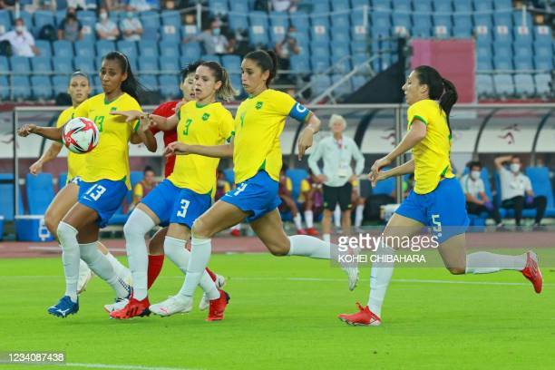Brazil's players defend a cross during the Tokyo 2020 Olympic Games women's group F first round football match between China and Brazil at the Miyagi...
