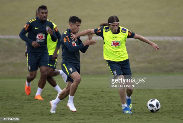 Brazil's players Filipe Luis and Philippe Coutinho vie for the ball during a training session of the national football team ahead of FIFA's 2018...