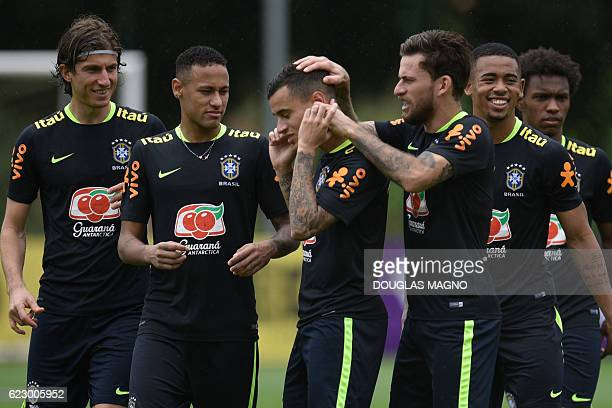 Brazil's players Filipe Luis Neymar Philippe Coutinho Lucas Lima Gabriel Jesus and Willian are pictured during a training session of the national...