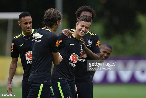 Brazil's players Neymar Filipe Luis Philippe Coutinho and Willian are pictured during a training session of the national football team at the...