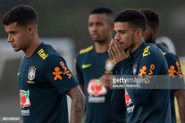 Brazil's players Philippe Coutinho and Taison attend a training session of the national football team ahead of the FIFA 2018 World Cup at Granja...