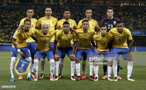 Brazil's' players pose for pictures before the start of their 2018 World Cup qualifier football match against Chile in Sao Paulo Brazil on October 10...