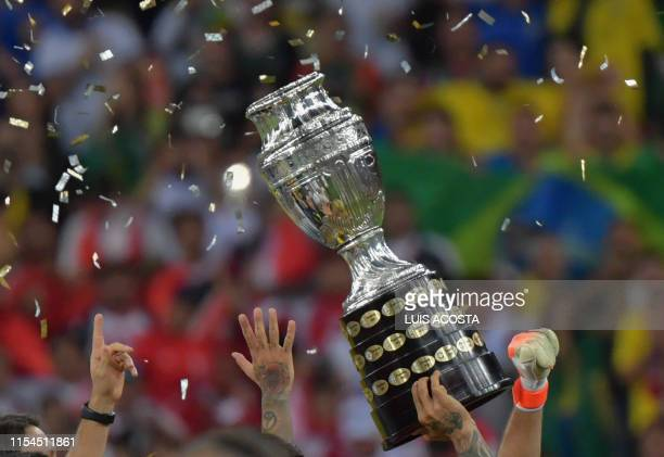 Brazil's players raise the trophy after winning the Copa America by defeating Peru in the final match of the football tournament at Maracana Stadium...