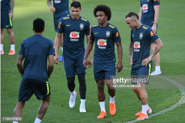 Brazil's players Thiago Silva Willian and Everton take part in a training session in Belo Horizonte Brazil on July 1 2019 on the eve of the Copa...
