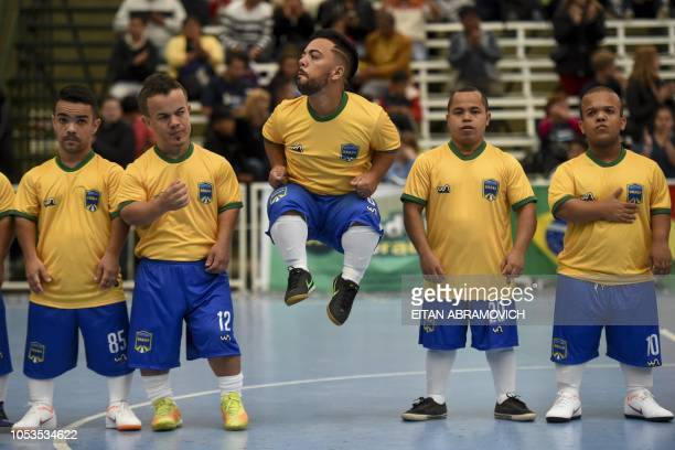 TOPSHOT Brazil's players wait for the start of a Dwarf Copa America football match against Morocco at Ferro Carril Oeste Club in Buenos Aires on...