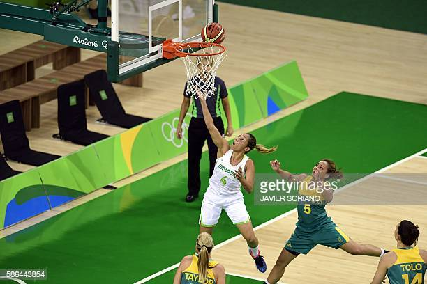 Brazil's point guard Adriana Moises scores during a Women's round Group A basketball match between Brazil and Australia at the Youth Arena in Rio de...