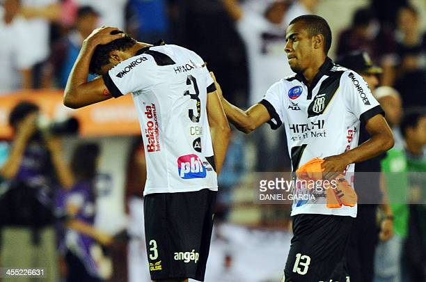 Brazil's Ponte Preta defender Regis comforts teammate defender Cesar at the end of their match against Argentina's Lanus at the Copa Sudamericana...