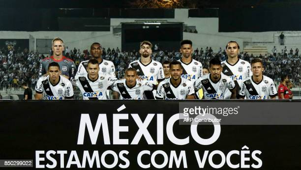 Brazil's Ponte Preta team poses with a banner that reads 'Mexico We Are With You' before their 2017 Sudamericana Cup football match against Brazil's...