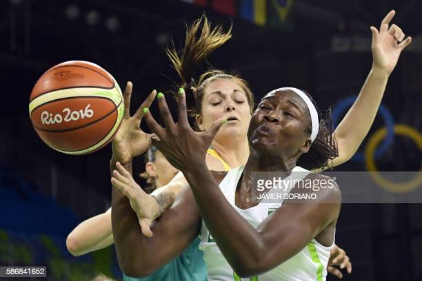 TOPSHOT Brazil's power forward Clarissa Santos vies with Australia's forward Cayla George during a Women's Group A basketball match between Brazil...