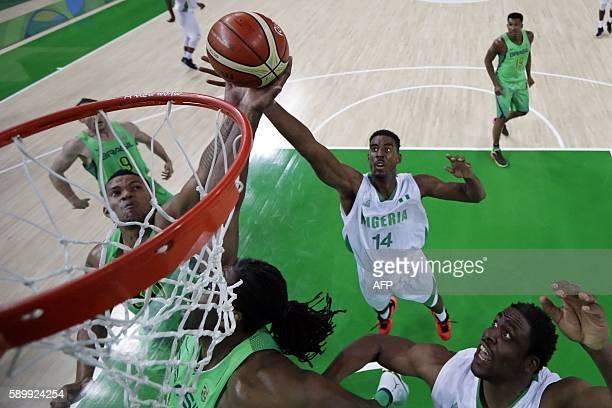 Brazil's power forward Rafael Hettsheimeir and Nigeria's power forward Alade Aminu go for a rebound during a Men's round Group B basketball match...