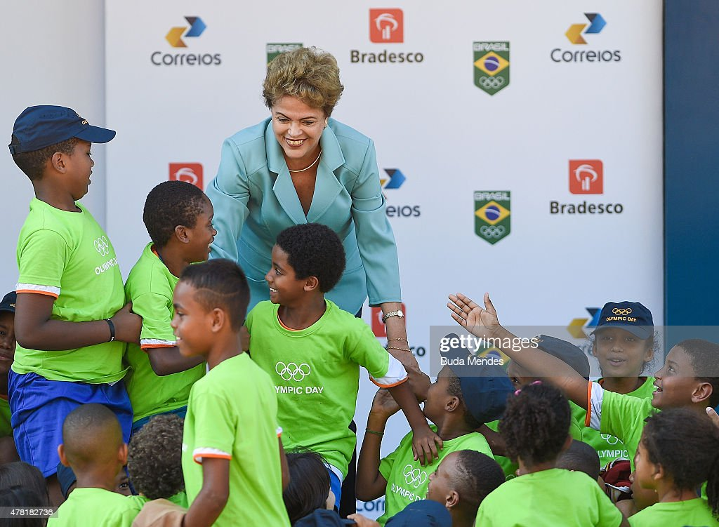Brazil's President Dilma Rousseff is greeted by children during the Olympic Day celebration and presentation of Brazilian national teams mascot Ginga by the Brazilian Local Organizing Committee at Parque Aquatico Maria Lenk on June 23, 2015 in Rio de Janeiro, Brazil.