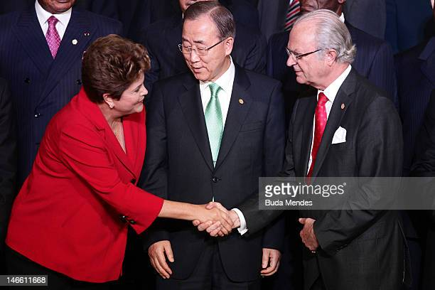 Brazil's President Dilma Rousseff shakes hands with Sweden's King Carl Gustaf as UN Secretary General Ban KiMoon looks on during the UN Conference on...