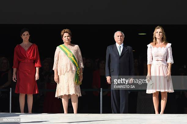 Brazil's President Dilma Rousseff takes part in a ceremony for her second term inauguration next to her daughter Paula her VicePresident Michel Temer...
