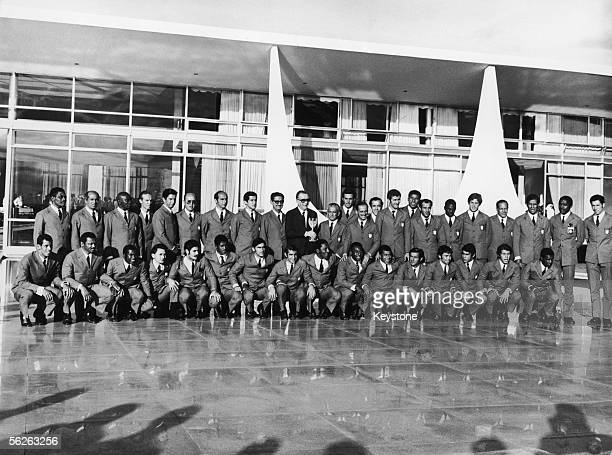 Brazil's President Garrastazu Medici holds the World Cup whilst standing with Brazil's football squad and staff including Pele Djalma Santos and...