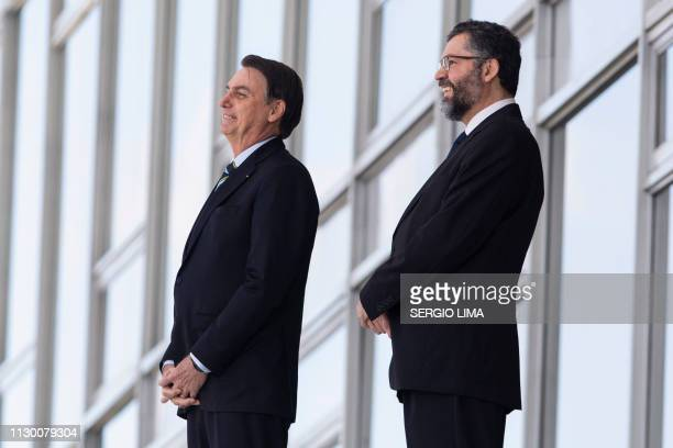 Brazil's President Jair Bolsonaro and and Foreign Minister Ernesto Araujo, welcome Paraguay's President Mario Abdo Benitez at Planalto palace in...