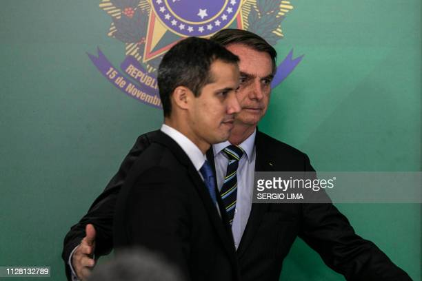 Brazil's President Jair Bolsonaro and Venezuelan opposition leader and self-declared acting president Juan Guaido are pictured during a joint press...