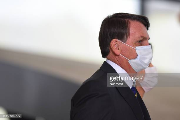 Brazil's president Jair Bolsonaro arrives to attend the launching ceremony of a campaign to support rural women at Palace in Brasilia Brazil on...