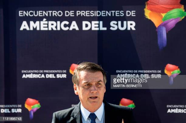 Brazil's President Jair Bolsonaro delivers a speech upon landing at Santiago's airport on March 21 2019 Bolsonaro is in Chile on a threeday official...