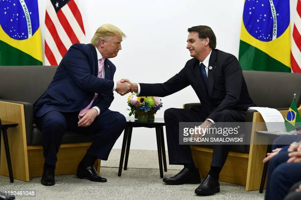 TOPSHOT Brazil's President Jair Bolsonaro meets with US President Donald Trump during a bilateral meeting on the sidelines of the G20 Summit in Osaka...