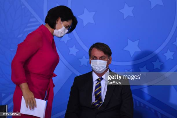 Brazil's president Jair Bolsonaro next to first lady Michelle Bolsonaro attends the launching ceremony of a campaign to support rural women at Palace...