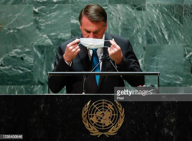 Brazil's President Jair Bolsonaro puts on his mask after addressing the 76th Session of the U.N. General Assembly on September 21, 2021 at U.N....