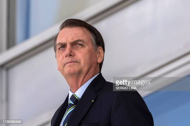 Brazil's President Jair Bolsonaro welcomes Paraguay's President Mario Abdo Benitez at Planalto palace in Brasilia on March 12 2019