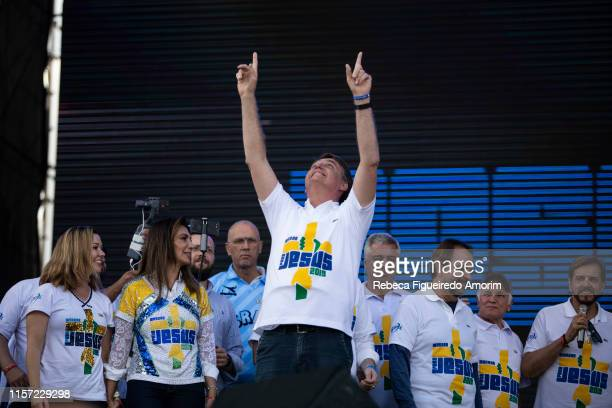 Brazil's President Jair Messias Bolsonaro looks up while he participates of March for Jesus on June 20 2019 in Sao Paulo Brazil