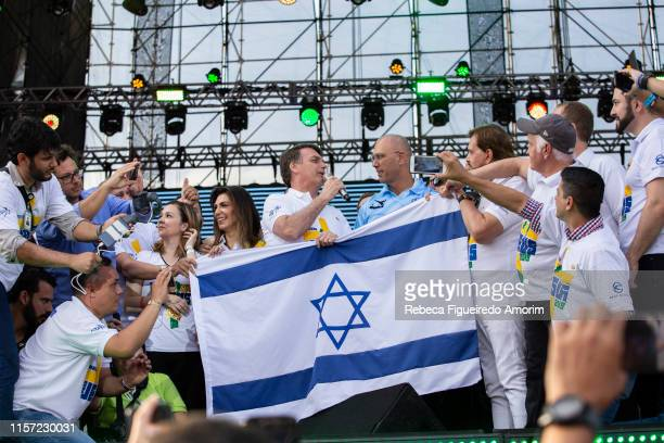 Brazil's President Jair Messias Bolsonaro talks to Israel's ambassador Yossi Shelley during their participation at March for Jesus on June 20 2019 in...