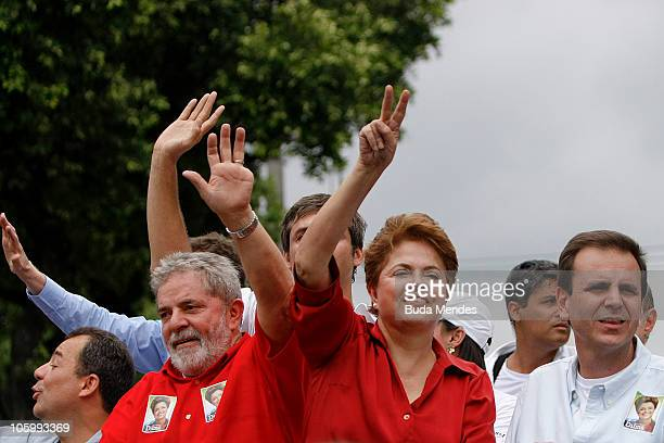 Brazil's President Luiz Inacio Lula da Silva and presidencial candidate Dilma Rousseff of the governist Workers' Party parade during a rally in the...
